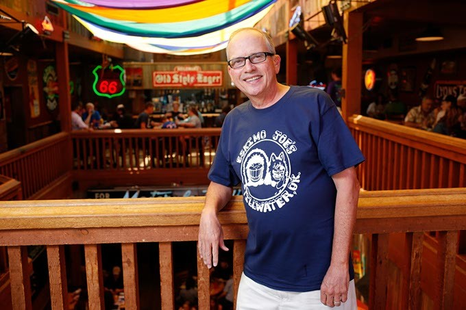 Stan Clark pauses inside his flagship Eskimo Joe's restaurant in Stillwater. (Garett Fisbeck)