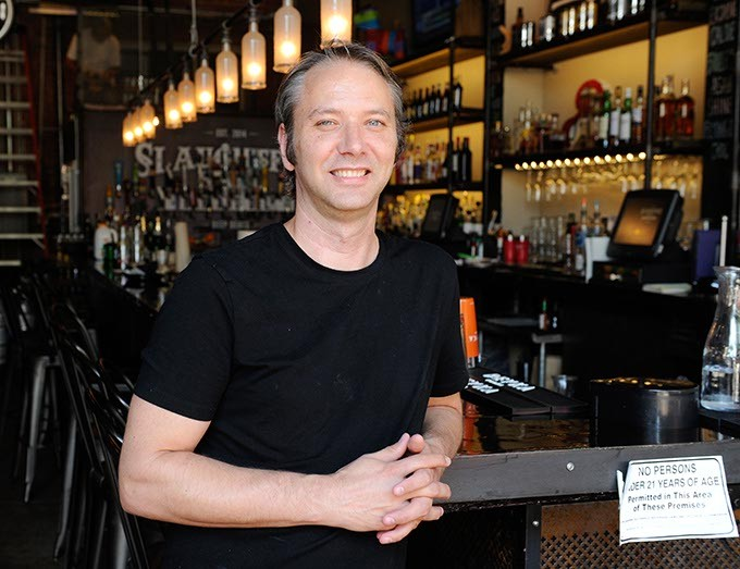 Chef Jonathan Groth, new executive chef of Slaughter's Hall and WKSY Lounge, poses for a photo in Oklahoma City, Monday, Sept. 14, 2015. - GARETT FISBECK