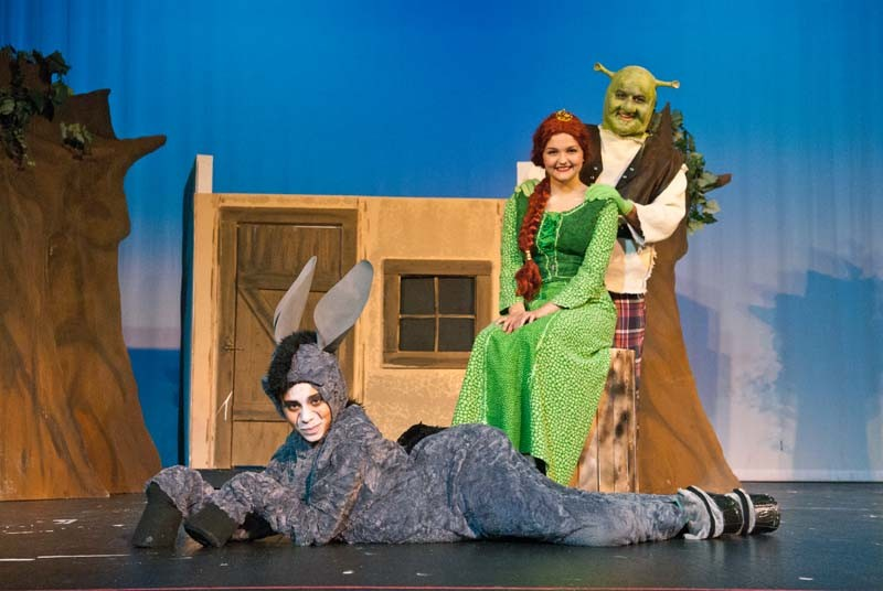 Kylie Anderson plays Donkey, Sarah Royse plays Fiona and Boston Cervantes plays Shrek in Sooner Theatre's presentation of Shrek The Musical.  mh