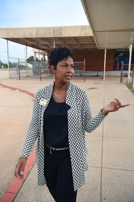 Millwood Public Schools Superintendent, Cecilia Robinson-Wood, points out a new playground while passing between the elementary and middle schools, 10-5-15. - MARK HANCOCK