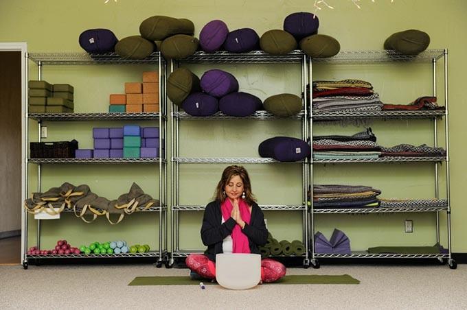Sara Alavi leads a Yoga class at Yoga Home School of Therapeutics in Oklahoma City, Friday, March 20, 2015. - GARETT FISBECK