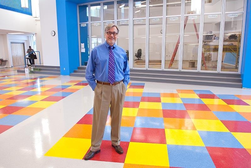 Joe Pierce, Head of School, inside a commons area at the new John Rex School.  mh