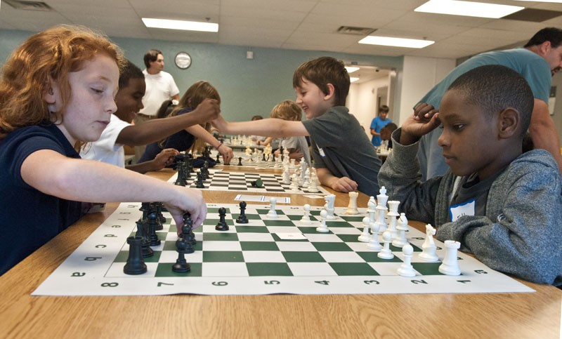 Students playing chess as part of the new chess program at Wilson Elementary, 9-23-14.  mh