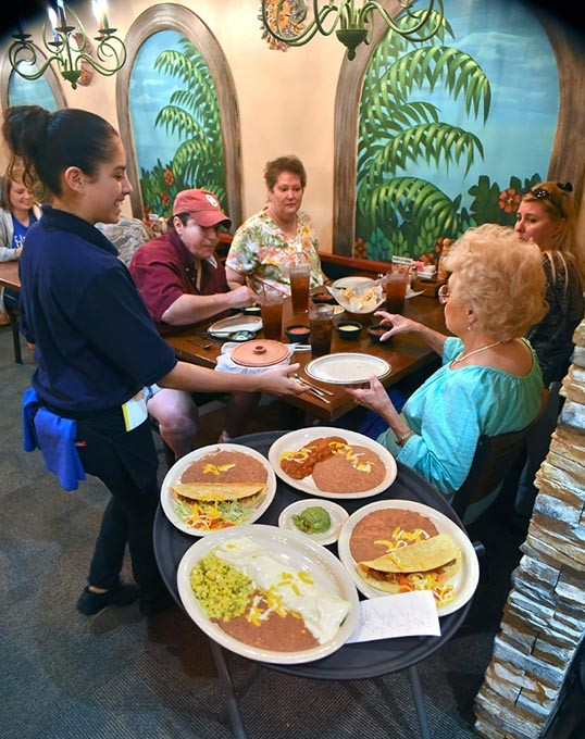 Waitress Laura Sanchez serves a family for lunch at the Del City Ted's Escondido, 9-23-15. - MARK HANCOCK