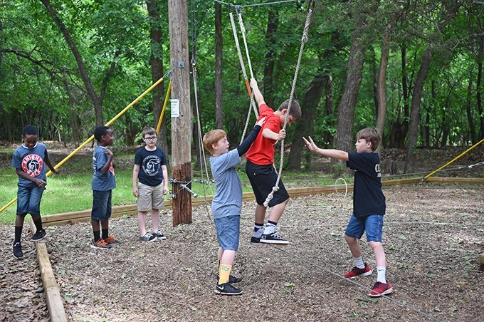 Kids from Crossings Christian School play on a ropes course at Camp Dakani recently.  mh