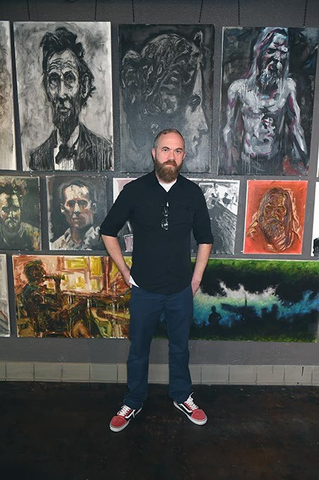 Artist J. Chris Johnson with his art showing at Brass Bell Studios. - MARK HANCOCK