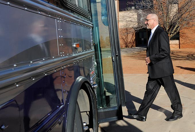 Oklahoma City Superintendent Rob Neu gets on a bus at Centennial High School in Oklahoma City, Wednesday, Jan. 28, 2015.  Legislators were given tours of F schools in the Oklahoma City public school system. - GARETT FISBECK