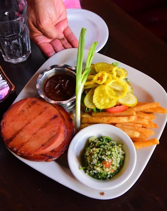 Jamils Steakhouse baloney sandwich, with tabouli, french fries, garnishes and sauce, oh, and that's Greg Gawey linding a hand, 9-4-15. - MARK HANCOCK