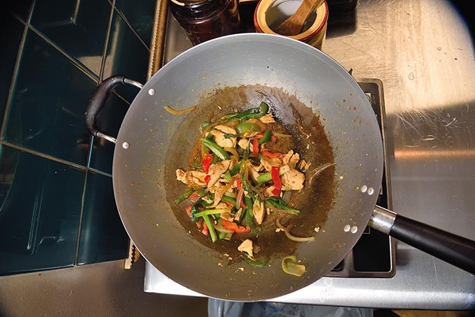 Basil Stir-Fry, in the wok during preparation at Thai Rice & Noodle Cafe in Del City, 12-28-15. - MARK HANCOCK