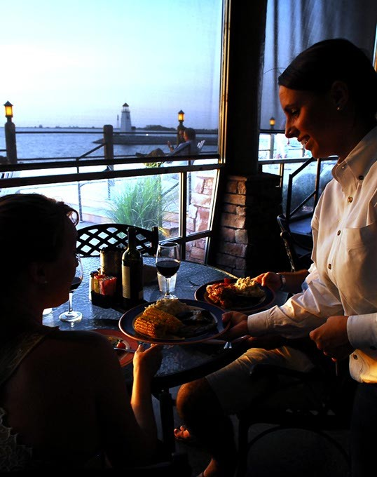 Dining with a view at the Redrock Canyon Grill, on Lake Hefner in Oklahoma City, 7-4-2009. - MARK HANCOCK