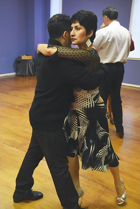 Hazel Lopez, owner of the International Dance Studio, dances with Ricky Sepulveda, where beginning and advance Tango classes are held each Wednesday evening.  mh