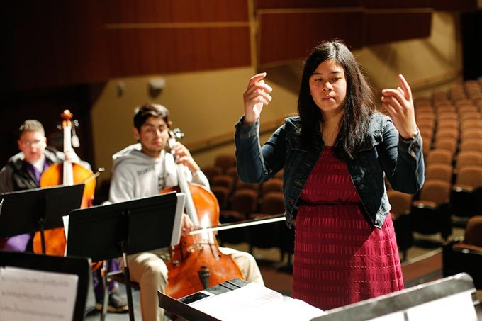 Samantha Sy leads an orchestra class at NW Classen High School in Oklahoma City, Thursday, May 7, 2015. - GARETT FISBECK