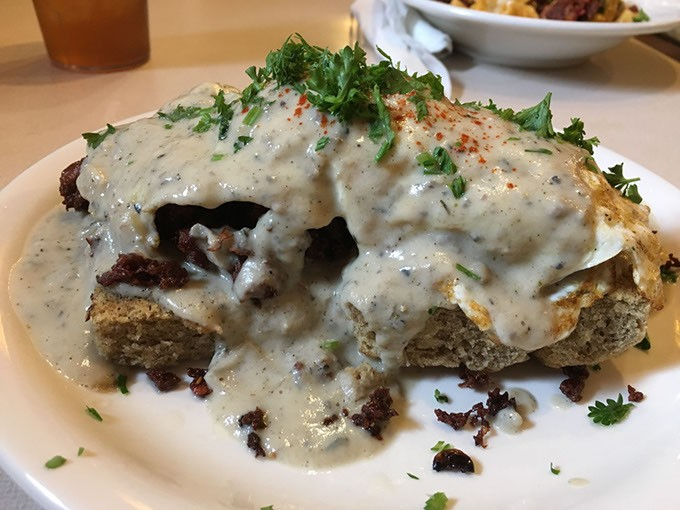 The Red Cup's gluten-free biscuit and gravy is topped with plant-based sausage and vegetable gravy. | Photo Jacob Threadgill