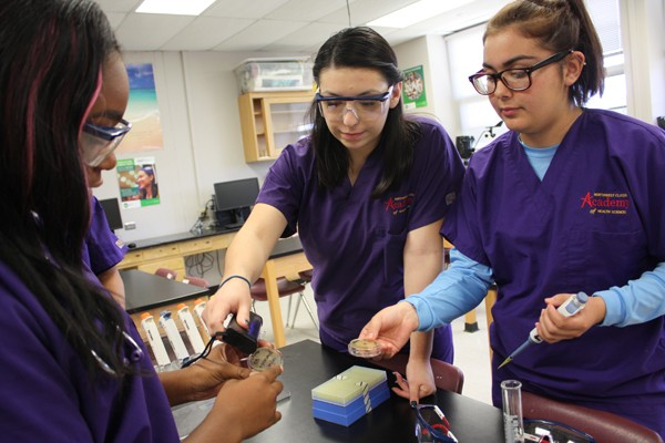 from left Marilu Cardenas and Cassidy Lopez perform a bio lab at Northwest Classen High School. They are part of the first graduating class of the school's Academy of Health Sciences. | Photo Laura Eastes