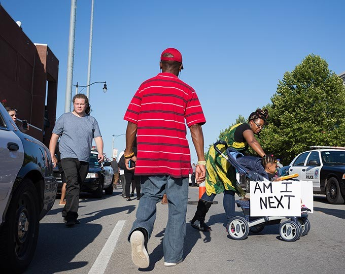 Mother and child carry a protest sign at the Black Lives Matter protest on Sunday, July 10, 2016 in Oklahoma City. - EMMY VERDIN