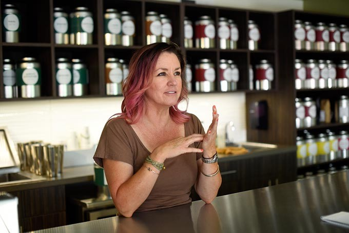 Urban Teahouse owner Kristy Jennings explains the brewing process. (Garett Fisbeck)