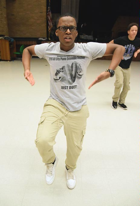 Jason Watts (Eagle Eye) performs with Brothers of Stomp during a demonstration of their step routines at Star Spencer High Schoo. (Mark Hancock / for Oklahoma Gazette)