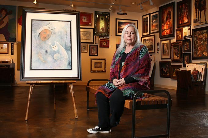 Connie Seabourn poses at 50 Penn Place Gallery, Tuesday, May 16, 2017.  The painting shown will be featured in her new exhibit, The Feminine Face of God, held at Oklahoma City University's Hulsey Gallery. - CARA JOHNSON