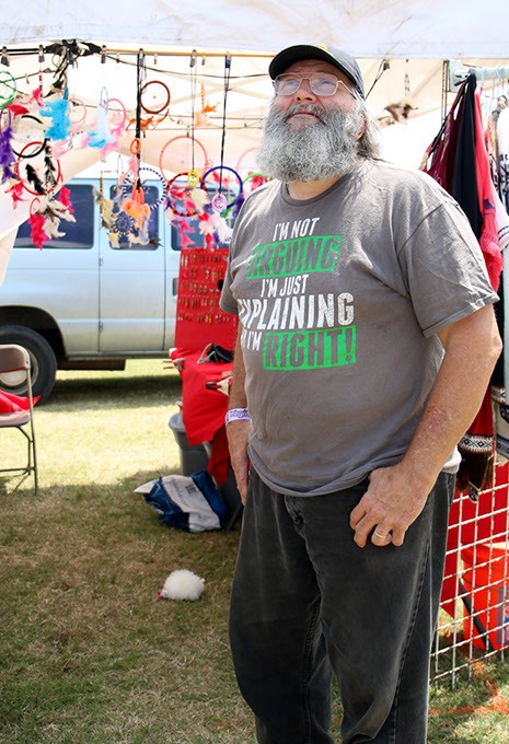 Vendor James Laird talks about the weather expected at Rocklahoma in Pryor, Okla. on Saturday, May 27, 2017. Concerts that night were canceled due to severe thunderstorms, wind, and flooding. (Cara Johnson).