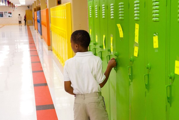 A student gets into his locker at F.D. Moon Elementary School.  mh