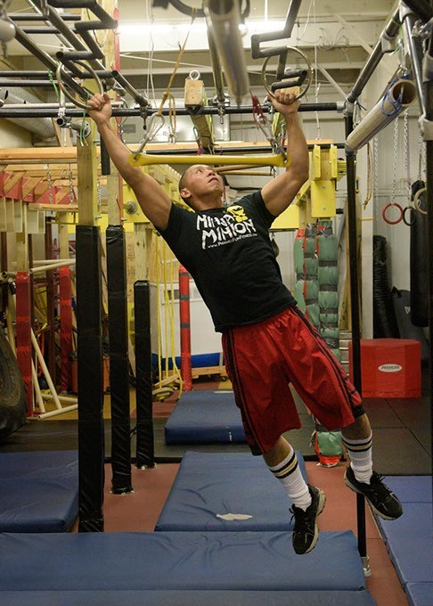 Dominic Pham goes through a drill at his ninja obstacle course. - GARETT FISBECK