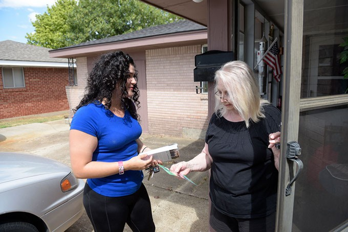 Elizabeth Larios talks with Patricia Fernandez during her visit to a Moore neighborhood. (Garett Fisbeck / file)