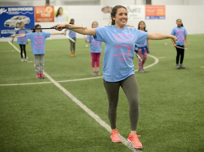 Haylee Chiariello twirls a baton at Indoor Soccer Arenas, Tuesday, March 14, 2017. - GARETT FISBECK