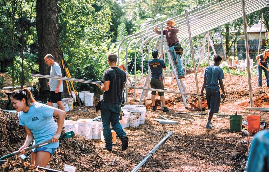 Volunteers raise a new hoop house to extend the growing season at CommonWealth Urban Farms of OKC. (Photo Bo Aptiz / provided)