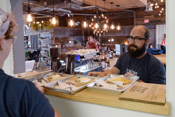Elizabeth Davis-Macias hands Chad Grubbs pastries at Okay Yeah Co., Wednesday, Sept. 7, 2016. - GARETT FISBECK