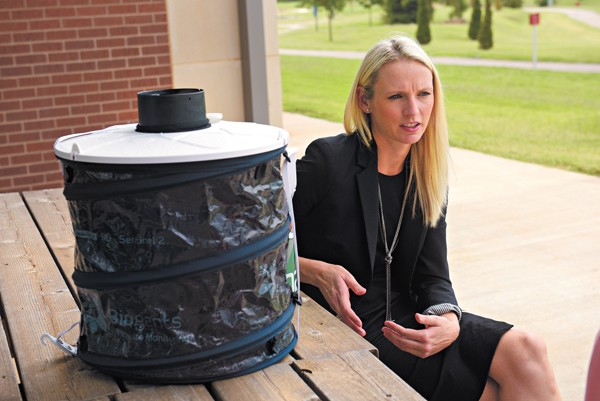Megan Souder talks about public health concerning the Zika virus as she sits next to a mosquito trap at the Oklahoma City-County Health Department. (Photo Garett Fisbeck)