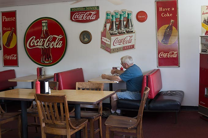 Dan's Ol' Time Diner decorates with vintage Coca Cola items in Oklahoma City, Tuesday, June 14, 2016. - EMMY VERDIN