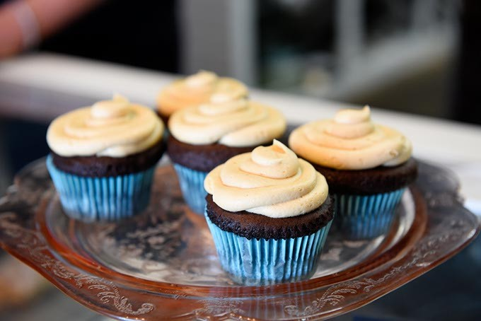 Dark chocolate cupcakes with salted caramel buttercream at Belle Kitchen, Tuesday, May 10, 2016. - GARETT FISBECK