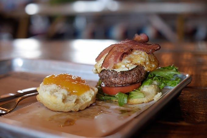 While Okay Yeah Co. is best-known for its homemade hand tarts, it also offers creative takes on diner favorites like its breakfast burger made with fresh veggies and house-made peach-bourbon jam. | Photo Garett Fisbeck