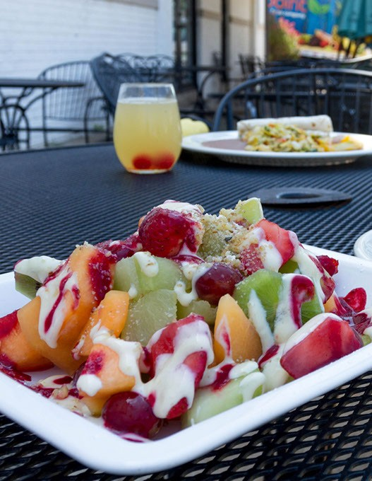 fruit salad(seasonal fruit and berries topped with anglaise sauce and raspberry sauce and garnished with chopped walnuts, served with a cafe comlette. Best of latin restaurant 2015. Taken in Oklahoma City, Thursday, August 6, 2015. - KEATON DRAPER
