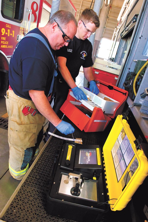 HAZ MAT firefighters left, TJ Thomson and Brent Bloyed test a Hazmat ID system at Station 5. Photo/Shannon Cornman - SHANNON CORNMAN