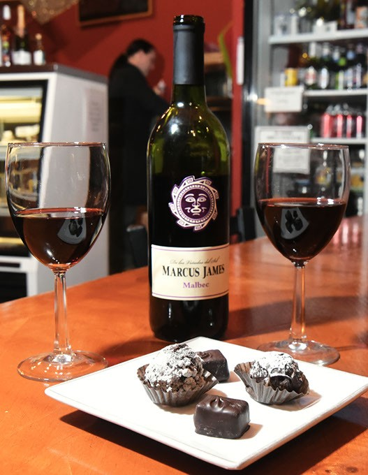 Wine and chocolate make for a romantic get together, at Michaelangelo's Coffee and Wine in Norman, 1-21-16. - MARK HANCOCK