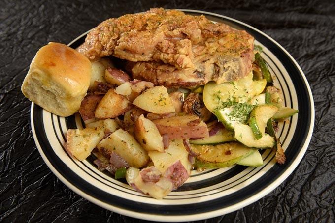 Pork chop dinner with home fries at Aja Bleu Cafe in Oklahoma City, Wednesday, Oct. 19, 2016. - GARETT FISBECK