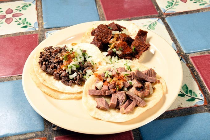 Azada, Milaneza, and Lengua tacos at Carnitas Michoacan in Edmond, Thursday, May 26, 2016. - GARETT FISBECK