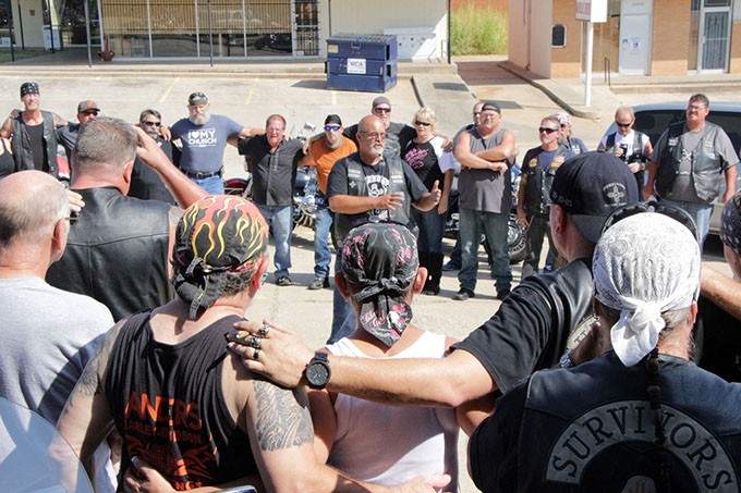 "Willie ""Farm Boy"" Moore, president of the Central Oklahoma Survivors Motorcycle Club gives safety and route instructions to participants in last year's Ride for Recovery poker run benefiting Camp ClapHans. - PHOTO BY SHARLA BARDIN"