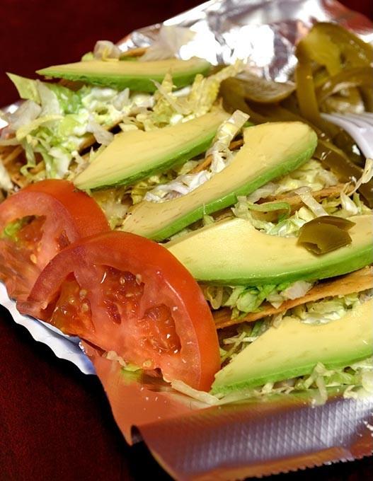 Tacos de papa, at Taqueria la Tropicana, 12-21-15. - MARK HANCOCK