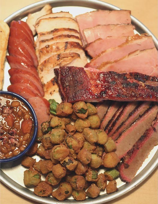 The Oklahoma Sampler at Swadley's BBQ. The dish features over a pound of meat including brisket, chicken, ham, sausage and rib as well as two sides. (Cara Johnson).