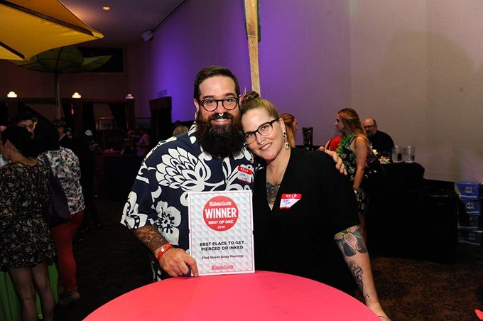 Jason and Tisha King show off their 23rd Street Body Piercing award for best place to get pierced or inked.
