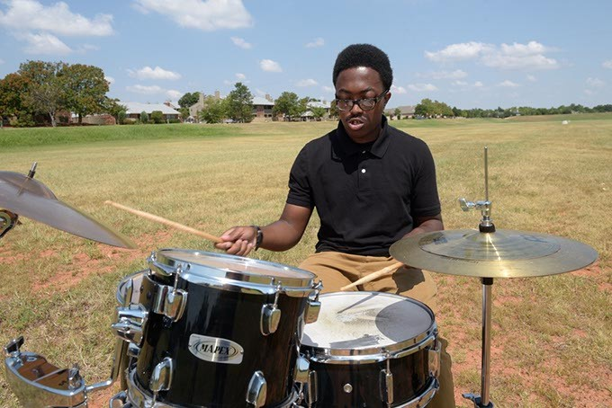 Zacharias Paris plays his drums in a spillway near his apartment. (Garett Fisbeck)