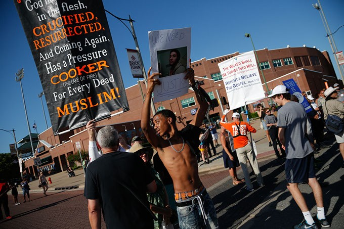 Protesters clash during a Black Lives Matter demonstration in Oklahoma City, Sunday, July 10, 2016. - GARETT FISBECK
