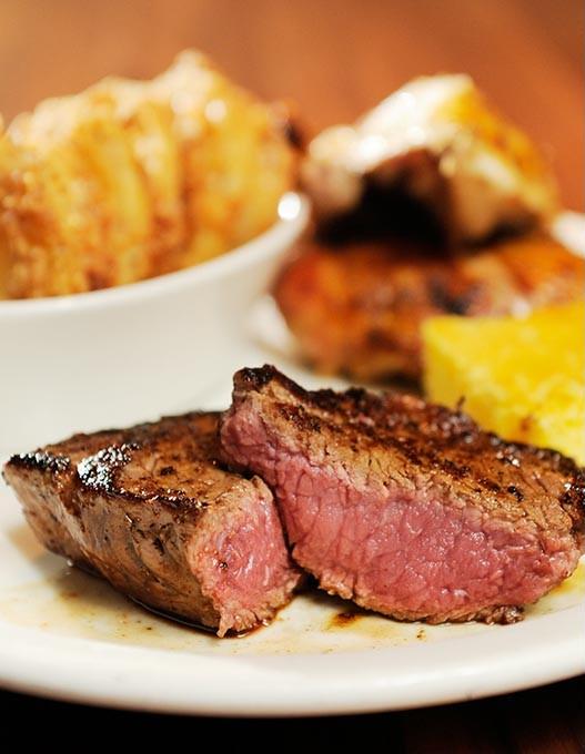 Steak and yardbird combo at Hollie's Flatiron Steakhouse in Moore, Tuesday, Dec. 30, 2014. - GARETT FISBECK