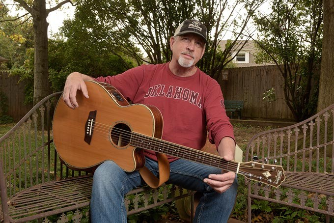 Musician Kent Fauss poses for a photo at his home, Tuesday, Oct. 25, 2016. - GARETT FISBECK