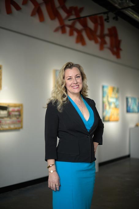 Kendra Horn, executive director of Women Lead, poses for a photo at Kasum Contemporary Fine Art, Wednesday, March 8, 2017. - GARETT FISBECK