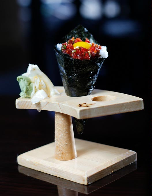 Toro-tartar hand roll at Okura Sushi in Oklahoma City, Wednesday, Nov. 11, 2015. - GARETT FISBECK