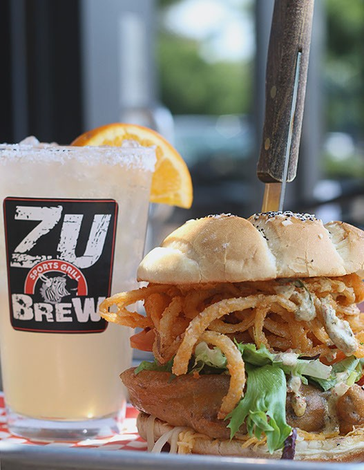 The Beer-Battered Bacon and Onion Burger with a Pink Zebra cocktail at The Zu in Edmond, Okla. (Cara Johnson).
