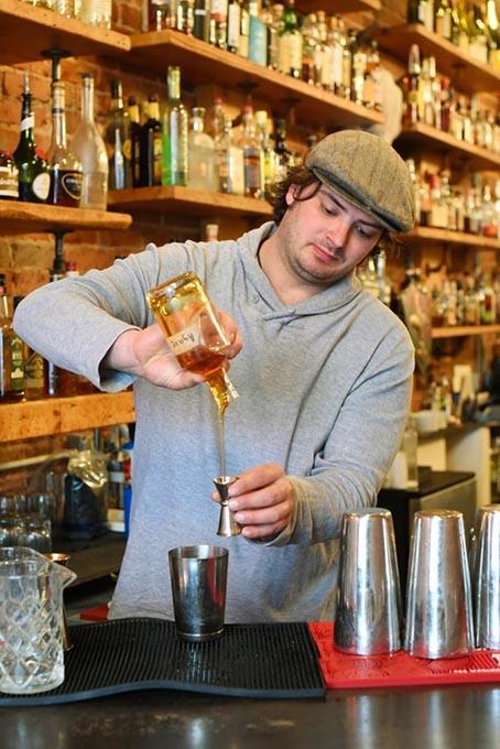 Colby Poulin makes a cocktail at Ludivine, Monday, April 11, 2016. - GARETT FISBECK